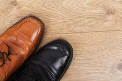 Shoes on a wooden floor Royalty Free Stock Image