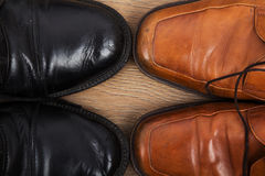 Shoes on a wooden floor Stock Photography