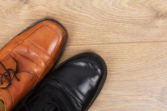 Shoes on a wooden floor Royalty Free Stock Photography