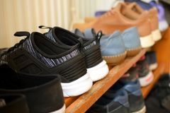 Shoes on wooden shoe rack. Close up side view image Stock Images