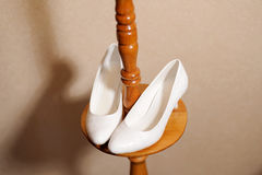 Shoes on Wooden Stand Royalty Free Stock Photography