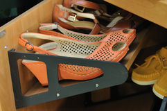 Shoes on wooden storage cabinet Stock Photos