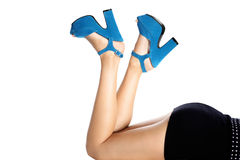 Shoes worn by female legs Royalty Free Stock Images