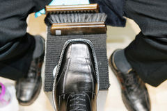 Shoeshine boy at work Royalty Free Stock Photo