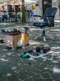 Shoeshiner Equipments in the Street: Chair, Wooden Footrest, Brushes and Rag Stock Images
