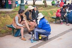 Shoeshiner working in Cusco street, Peru Royalty Free Stock Images
