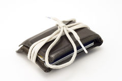 Shoestring Budget. Wallet wrapped in a shoestring stock photos