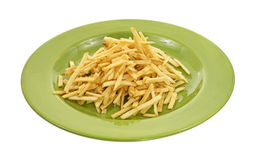 Shoestring potatoes on green plate Royalty Free Stock Photos
