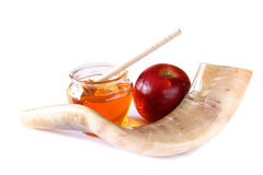 Shofar (horn), honey, apple isolated on white. rosh hashanah (jewish holiday) concept . traditional holiday symbol. Stock Photos