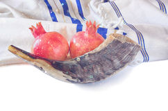 Shofar (horn), white prayer talit and pomegranate isolated on white. rosh hashanah (jewish holiday) concept . traditional holiday Royalty Free Stock Photo
