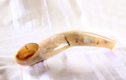 Shofar (horn) on white prayer talit. room for text. rosh hashanah (jewish holiday) concept . traditional holiday symbol. Royalty Free Stock Images