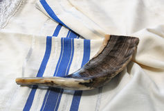 Shofar (horn) on white prayer talit. room for text. rosh hashanah (jewish holiday) concept . traditional holiday symbol. Royalty Free Stock Photography