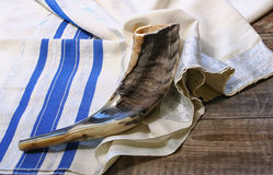 Shofar (horn) on white prayer talit. room for text. rosh hashanah (jewish holiday) concept . traditional holiday symbol. Shofar (horn) on white prayer talit Royalty Free Stock Images
