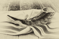Shofar (horn) on white prayer talit. room for text. rosh hashanah (jewish holiday) concept . traditional holiday symbol. Stock Photography