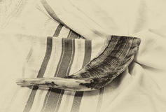 Shofar (horn) on white prayer talit. room for text. rosh hashanah (jewish holiday) concept . traditional holiday symbol. Shofar (horn) on white prayer talit Stock Photography