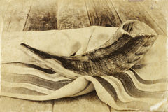 Shofar (horn) on white prayer talit. room for text. rosh hashanah (jewish holiday) concept . traditional holiday symbol. Stock Images