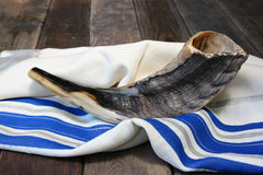 Shofar (horn) on white prayer talit. room for text. rosh hashanah (jewish holiday) concept . traditional holiday symbol. Shofar (horn) on white prayer talit Royalty Free Stock Photography