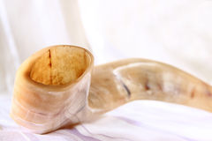 Shofar (horn) on white prayer talit. rosh hashanah (jewish holiday) concept . traditional holiday symbol. Stock Photography