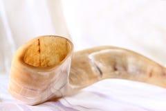 Shofar (horn) on white prayer talit. rosh hashanah (jewish holiday) concept . traditional holiday symbol. Shofar (horn) on white prayer talit. rosh hashanah ( Stock Photography