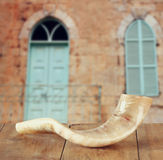Shofar (horn) on wooden table. rosh hashanah (jewish holiday) concept . traditional holiday symbol. Stock Image