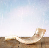 Shofar (horn) on wooden table. rosh hashanah (jewish holiday) concept . traditional holiday symbol. Stock Photos