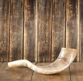 Shofar (horn) on wooden table. rosh hashanah (jewish holiday) concept . traditional holiday symbol. Stock Photography