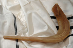 Shofar on Tallit. A ram's horn, called a shofar, used for the jewish new year, upon a tallit or prayer shawl Royalty Free Stock Photo