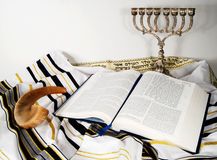 Shofar, Tallit and open book. Open Holy book on a tallit next to a shofar Royalty Free Stock Photography
