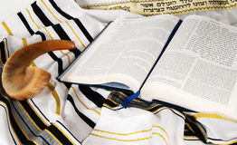Shofar, Tallit and open book. Open Holy book on a tallit next to a shofar Stock Photo