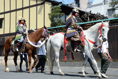 Shogun ride a horse. The two men ride the horses in cherry blossoms festival of Kyoto, JAPAN Stock Images