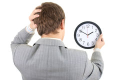 Shoked Businessman Holding A Clock Stock Photography