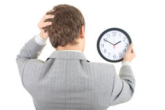 Shoked businessman holding a clock Royalty Free Stock Photography