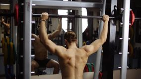 Sholder (Military) press seated in smith machine stock video footage