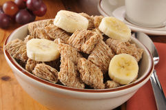 Shole wheat cereal with bananas. A bowl of whole wheat cold cereal with slices of banana Stock Photo