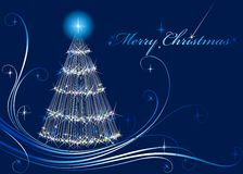 Shone Christmas fur-tree. Shone fur-tree on a dark blue background Stock Photo