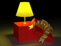 Shone lamp in a gift box. Royalty Free Stock Images