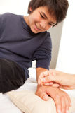 Shonishin Acupuncture with Yoneyama Tool Stock Photography