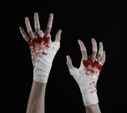 Shook his bloody hand in a bandage, bloody bandage, fight club, street fight, bloody theme, black background, isolated Stock Images