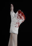 Shook his bloody hand in a bandage, bloody bandage, fight club, street fight, bloody theme, black background, isolated Stock Photography
