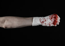 Shook his bloody hand in a bandage, bloody bandage, fight club, street fight, bloody theme, black background, isolated Royalty Free Stock Photography