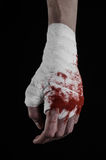 Shook his bloody hand in a bandage, bloody bandage, fight club, street fight, bloody theme, black background, isolated Stock Photo