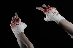 Shook his bloody hand in a bandage, bloody bandage, fight club, street fight, bloody theme, black background, isolated Stock Image