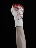 Shook his bloody hand in a bandage, bloody bandage, fight club, street fight, bloody theme, black background, isolated Royalty Free Stock Photos