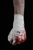 Shook his bloody hand in a bandage, bloody bandage, fight club, street fight, bloody theme, black background, isolated Royalty Free Stock Images