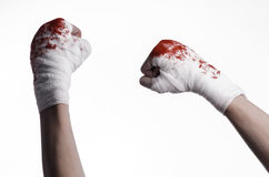 Shook his bloody hand in a bandage, bloody bandage, fight club, street fight, bloody theme, white background, isolated Stock Photos