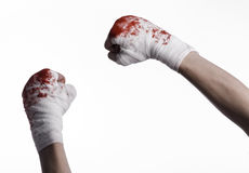 Shook his bloody hand in a bandage, bloody bandage, fight club, street fight, bloody theme, white background, isolated Stock Image