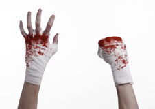 Shook his bloody hand in a bandage, bloody bandage, fight club, street fight, bloody theme, white background, isolated Royalty Free Stock Images
