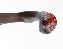 Shook his bloody hand in a bandage, bloody bandage, fight club, street fight, bloody theme, white background, isolated. Studio Stock Photo