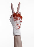 Shook his bloody hand in a bandage, bloody bandage, fight club, street fight, bloody theme, white background, isolated. Studio Royalty Free Stock Image