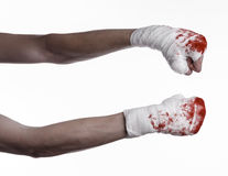 Shook his bloody hand in a bandage, bloody bandage, fight club, street fight, bloody theme, white background, isolated. Studio Stock Image